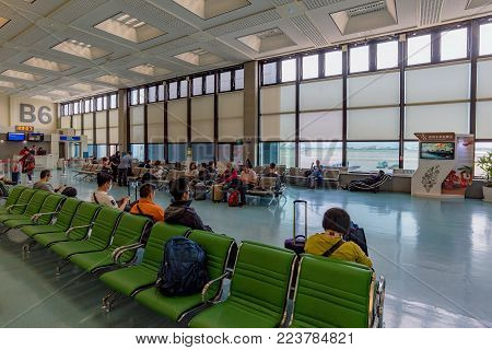 TAOYUAN, TAIWAN - APRIL 24TH: Flight gate waiting area for people waiting to board their flight in Taoyuan international airport on April 24, 2017 in Taoyuan