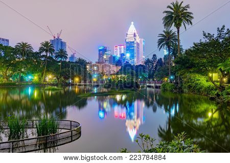 TAIPEI, TAIWAN - APRIL 20: This is a night view of Zhonghsan park and Xinyi financial district architecture in donwtown Taipei on April 20, 2017 in Taipei
