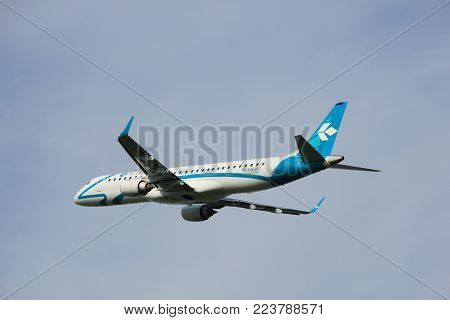 Amsterdam, the Netherlands  -  June 2nd, 2017: I-ADJU Air Dolomiti Embraer ERJ-195LR taking off from Polderbaan Runway Amsterdam Airport Schiphol