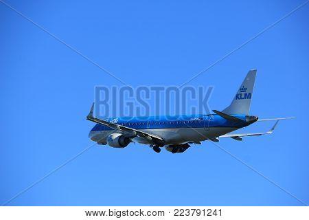 Amsterdam the Netherlands - January 7th 2018: PH-EXB KLM Cityhopper Embraer ERJ-190 takeoff from Polderbaan runway.