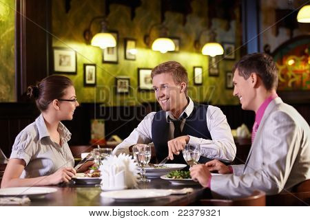Young people have dinner at a restaurant