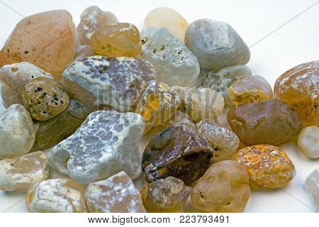 Closeup of a collection of Agate stones found at the beach