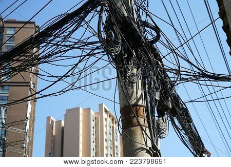 Electrical cable wire on the pole in mess