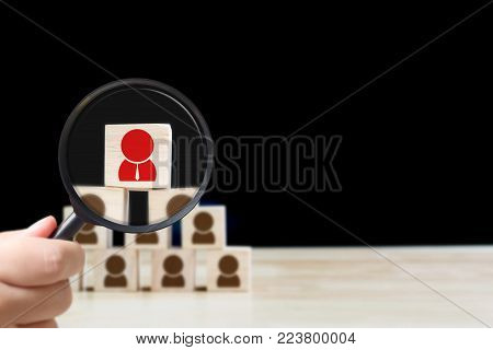Human resources management and recruitment business hiring concept, Hand held magnifying glass, Copy space for your text