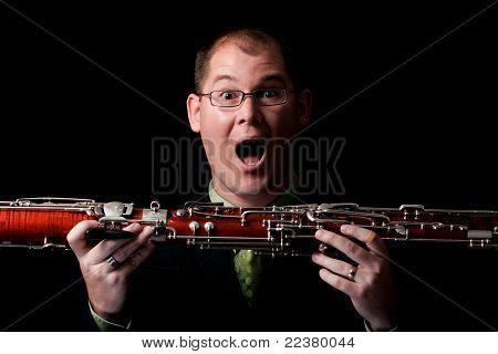 Surprised Caucasian Male Holding Bassoon