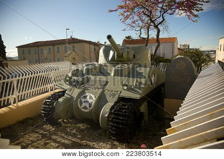 MARSEILLE, FRANCE - april 27.2013 Jeanne d'Arc WW2 battle tank memorial on the street of Marseille France in the spring against the background of cherry blossoms