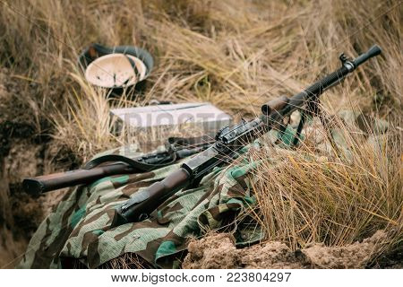 Gomel, Belarus - November 26, 2017: Czech machine gun ZB vs. 26 during the Second World War in autumn dry grass