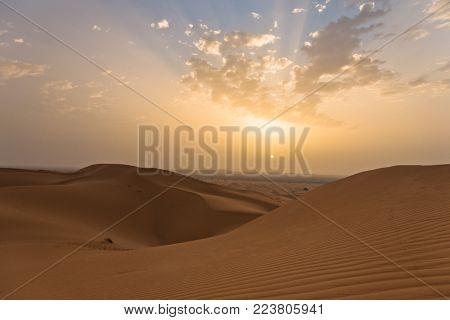 Sunrise over sand dunes in Erg Chebbi,  Sahara desert, Morocco, Africa