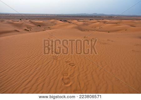 Steps in a sand at the edge of Sahara desert, Erg Chebbi, Morocco, Africa