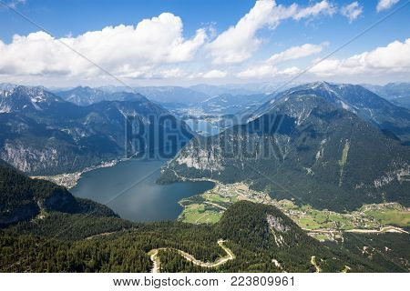 Panoramic aerial view of Hallstatt lake and Alp mountain from high viewpoint