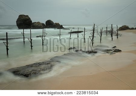 The stilt fishermen at Koggala Beach in Sri Lanka