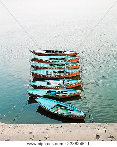 Boats at the river Ganges near holy ghats   in Varanasi, India early morning