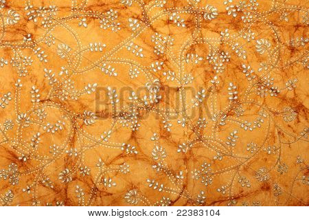 light brown handmade art paper with floral print