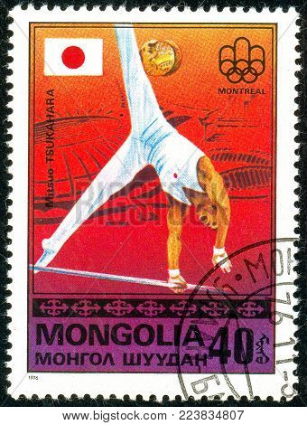 Ukraine - circa 2018: A postage stamp printed in Mongolia show gymnast Mitsuo Tsukahara and Japanese flag. Series: Medalists from Montreal. Circa 1976