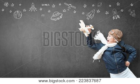 Kid in pilot costume and imagination dream in learning inspiration world in innovative science technology engineering maths STEM education and universal children's day concept