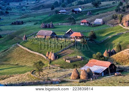 Beautiful rural mountain landscape in the sunrise morning light, Fundatura Ponorului, Hunedoara County, Romania