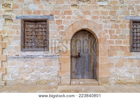 Door and two windows of one of the rooms surrounding the main yard of the citadel of Alexandria, Egypt