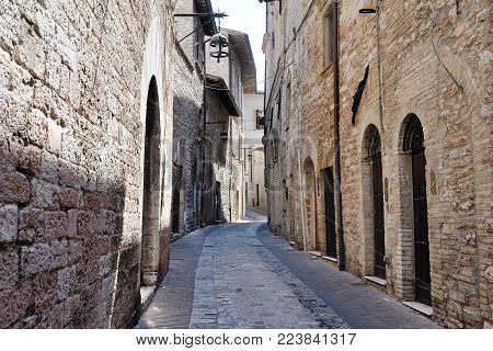 Medieval street in the Italian hill town of Assisi. The traditional italian medieval historic center in Umbria. Italy