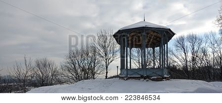 Pavilion in the Kiev park Vladimir Hill on a winter snowy day. Observation platform over the Dnieper