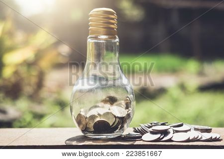 Stacking coins and money growing for saving, Coin in glass bottle with money stack for business planning investment.