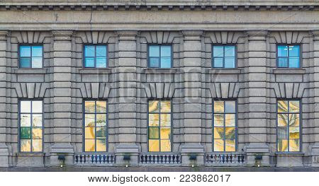 Several windows in a row on the facade of the urban historic building front view, Saint Petersburg, Russia