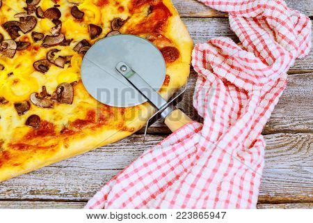 Home made pizza cutting ready for lunch ready pizza for cutting