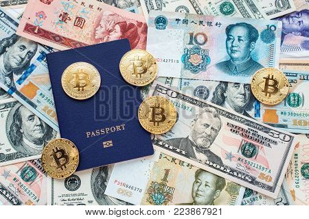 Blue passport on background, proof of identity. Against paper money, US dollars, Chinese yuan CNY, metal coins, bitcoin, crypto currency, customer identification.