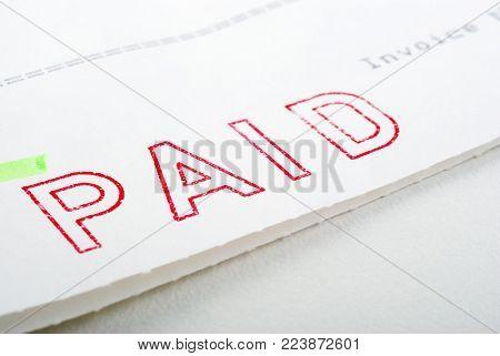 Macro of Paid stamp on invoice, shallow DOF