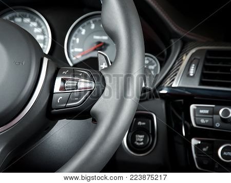 media control buttons on the steering wheel, modern luxury car interior details