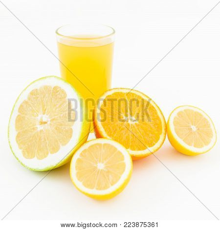 Citrus juice made of lemon, orange and sweetie on white background. Flat lay, top view. Fruit's background