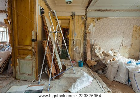 Dismantling of apartment interior before upgrade  or  remodeling, renovation, extension, restoration, reconstruction and construction. ( sacks with construction waste and rubbish). poster
