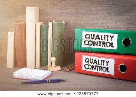 Quality Control. Binders on desk in the office. Business background.