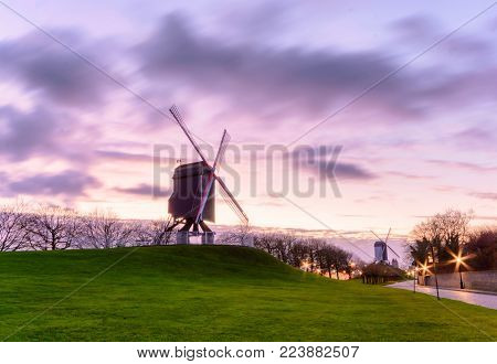 The windmil from Bruges, Belgium 2017. Captured during my christmas vacation. This windmill is part of working windmills in Bruges. Sun is playing hide and seek in the cloud