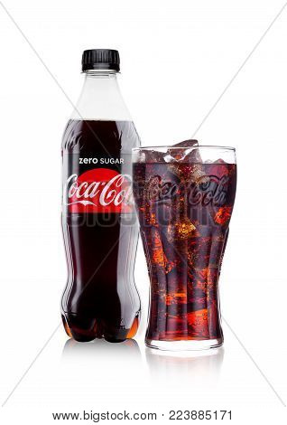 LONDON, UK - JANUARY 24, 2018: Bottle and glass of Zero  Coca-Cola on white Background. Coca-Cola is one of the most popular soda products in the world.