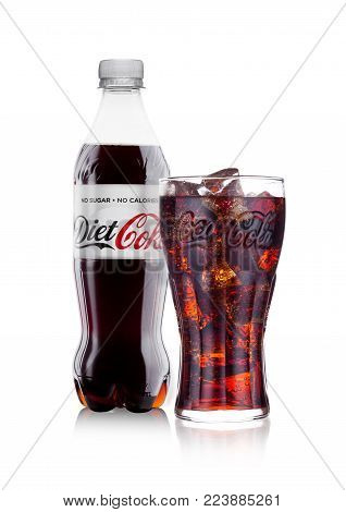 LONDON, UK - JANUARY 24, 2018: Bottle and glass of Diet Coca-Cola on white Background. Coca-Cola is one of the most popular soda products in the world.