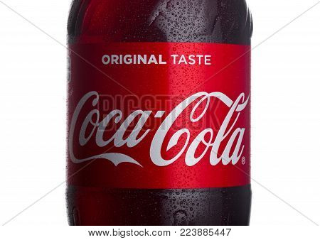 LONDON, UK - JANUARY 24, 2018: Bottle label of Classic Coca-Cola on white Background. Coca-Cola is one of the most popular soda products in the world.