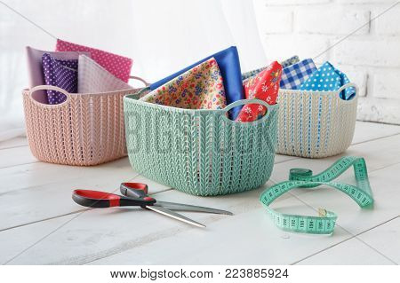 Home Organizers Colored Baskets On White Table