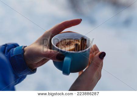Mulled Wine In Hand In Winer Outdoor