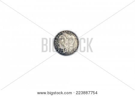 1887 Silver Dollar isolated on white. Antique american silver dollar from 1887