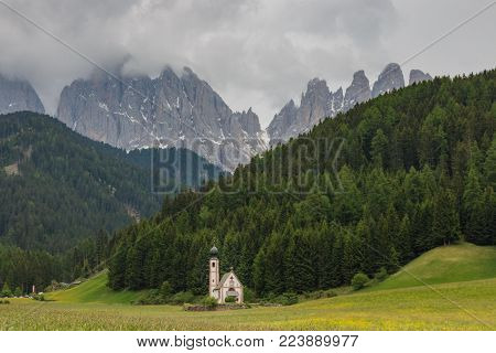 The little church of Ranui in St. Maddalena (Val di Funes) in front of dolomites mountains is one of the most popular photo motifs in the Italian alps