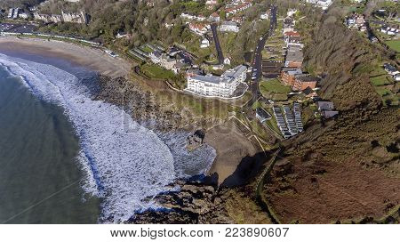 Editorial SWANSEA, UK - JANUARY 26, 2018: Ariel view of a small section of the Wales Coastal Path as it winds its way past Rotherslade Bay and Langland Bay on the Gower peninsula in Swansea, South Wales, UK.