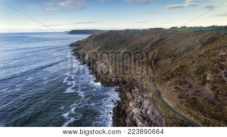 Editorial SWANSEA, UK - JANUARY 26, 2018: Wales Coastal Path, a long-distance footpath which runs along the majority of the coastline of Wales seen here as it stretches from Langland Bay towards Caswell Bay