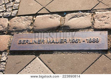BERLIN, Germany - APRIL 24, 2011: A memorial plate where berliner wall was standing before it was removed in 1989