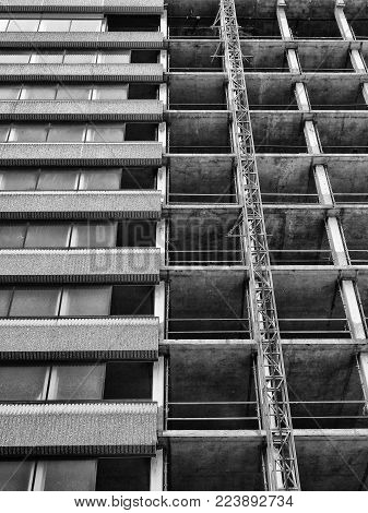 partly demolished old concrete high rise tower block building