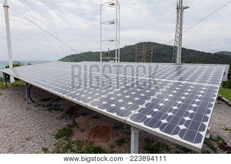 Solar panels,wind turbines on sky background,natural Energy