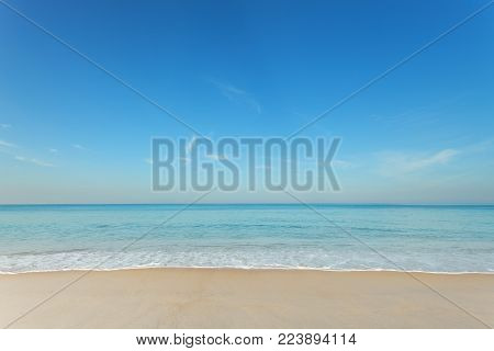 Tropical andaman seascape scenic off mai khao beach and wave crashing on sandy shore in phuket thailand,can be used for air transport to travel and open season to travel background