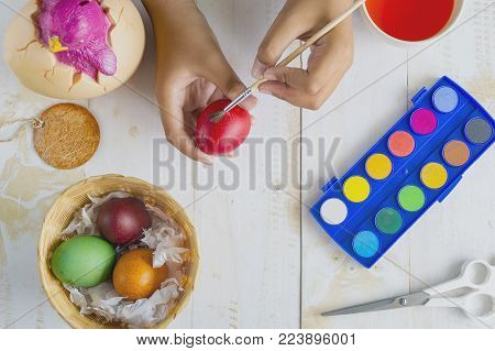 Colouring eggs for eastertime at home their kids painting Easter eggs.Happy easter day.
