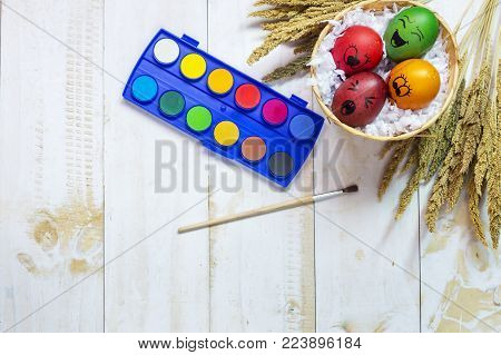 Easter eggs painted on white wooden background. Easter concept