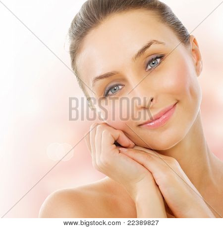 Beautiful Healthy Woman touching her skin. Middle Aged