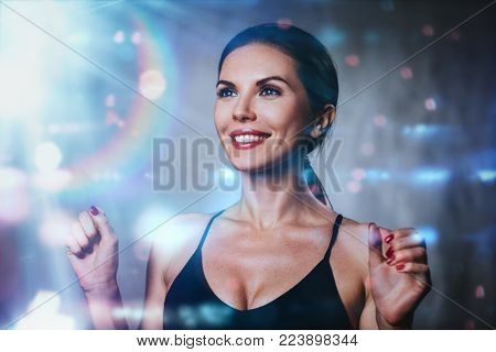 Young happy smiling brunette woman portrait with lights and flares effects